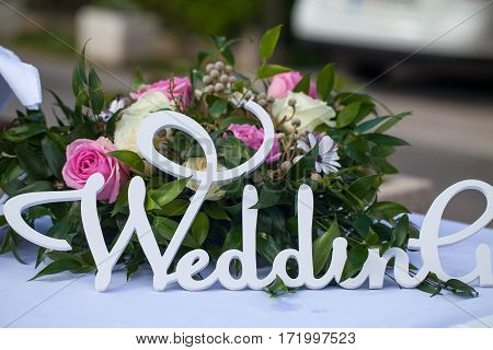 Wedding sign letters at decoration table with flowers