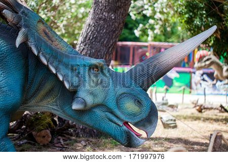 Giant monster dinosaur with big horn in park