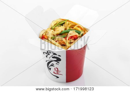 Glass rice noodles wok with vegetables in a box on a white background