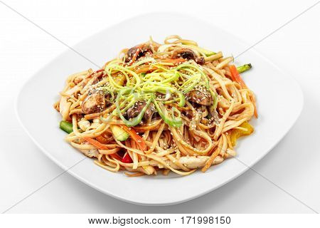 Fried noodles in Chinese in a white plate on a white background