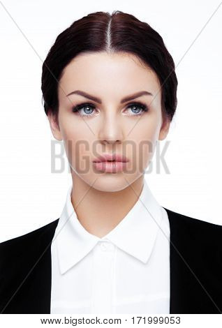 Business office girl portrait wearing black suit .Shot in studio on white background.