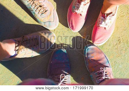 Friends Put Their Feet As A Sign Of Unity And Teamwork. Holi Festival Of Color .
