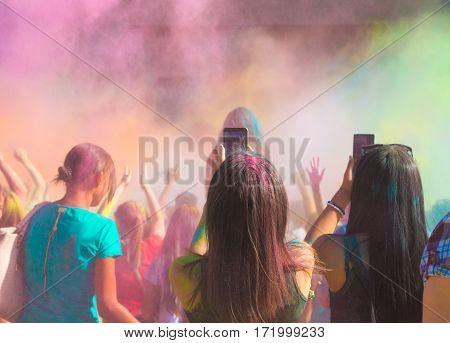 Celebrants Dancing During The Holi Festival