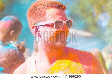 Portrait Of A Young Haooy Man In The Holi Festival Of Color