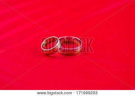beautiful Wedding ring on a red background