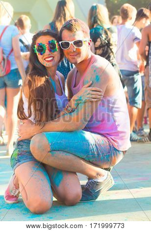 Portrait Of Happy Couple In Love On Holi Festival