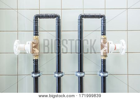 water pipes with valves on the wall