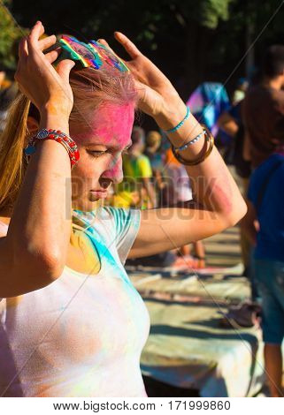 Portrait Of Young Blondy Girl On Holi Color Festival