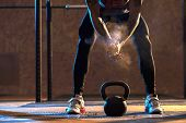 Muscular man exercising with kettlebell in gym. Weightlifting training. sports, fitness concept. poster