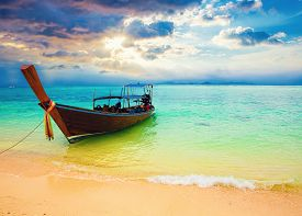 Longtail boat near the beach at sunset. Bamboo island. Phi-Phi islands Thailand