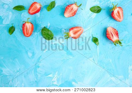 Strawberry And Basil On Blue Background. Flat Lay