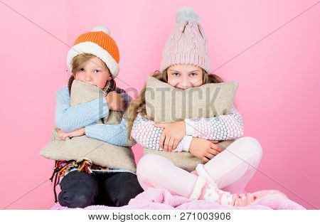 Warm Up Your Winter Wear With Cute And Cozy Accessories. Siblings Wear Winter Warm Hats Sit On Pink