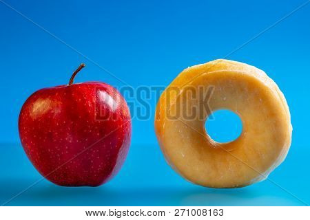 Apple And Donut, Concept Of Choice Health And Unhealthy Diet.