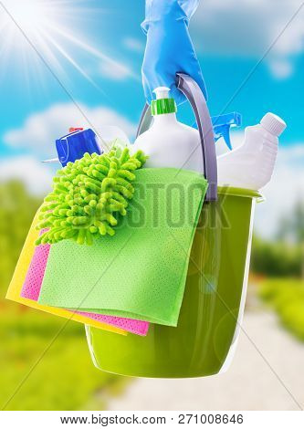 Cleaning Concept Of Cleaning Supplies Needed To Spring Cleaning. Cleaning Equipment At Spring Backgr