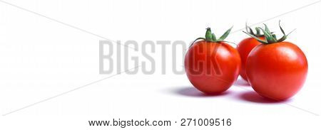 Close-up Of Fresh Red Tomatoes Isolated On Clean White Background.  Red Cherry Tomatoes With Green S