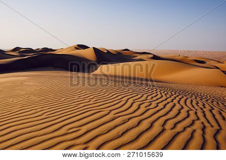 Sand Dunes In Desert Landscape. Wahiba Sands, Sultanate Of Oman.