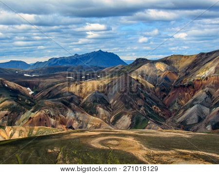 Landscape of Landamannalaugar geothermal area with vivid rhyolite mountains, black lava fields, snow and poor vegetation, Fjallabak Nature Reserve, Highlands of Iceland poster