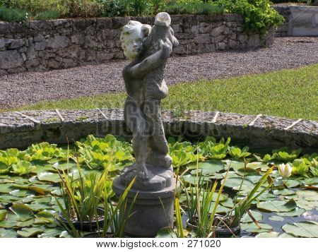 Statue In Pond