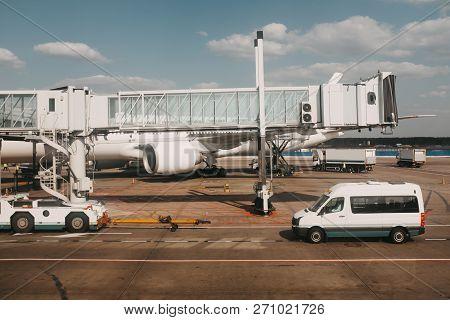 Air Plane In The Airport Near Jet Bridge