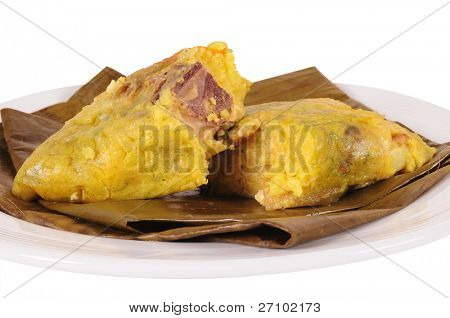 Tamal. Meat bone with chickpeas stuffed in a mashed corn. poster