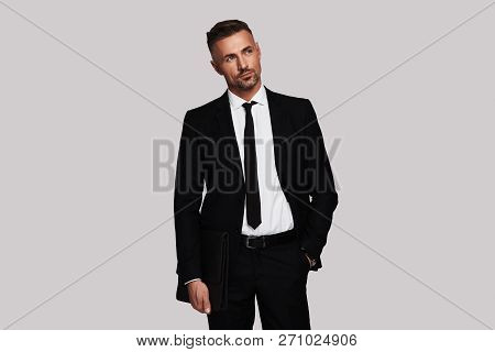 Quite Contemplation. Thoughtful Young Man In Full Suit Keeping Hand In Pocket And Looking Away While