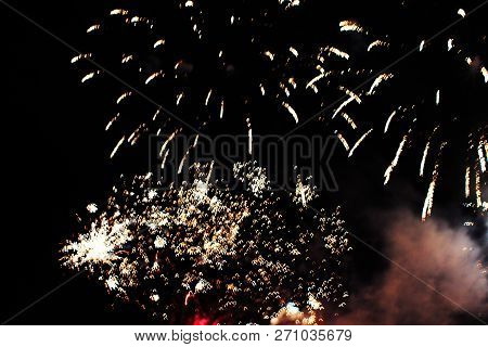 Fireworks. Firework. Heavenly Background. A Colorful Wave Of Bright Yellow Shining Lights In The Nig