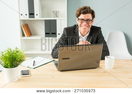 Office And Business People Concept - Young Man Smiling And Working In The Office