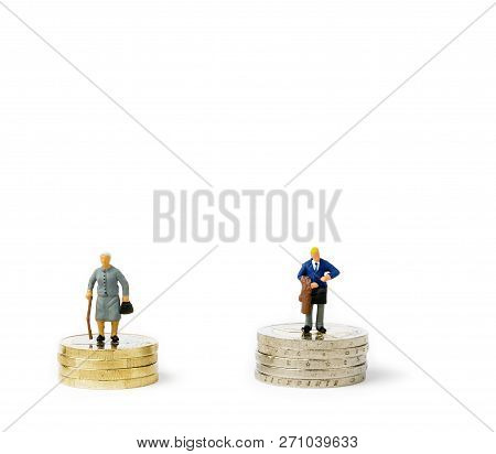 Small Figurines And Stacks Of Euro Coins On Bright Background. Economic Inequality By Gender. Inequa