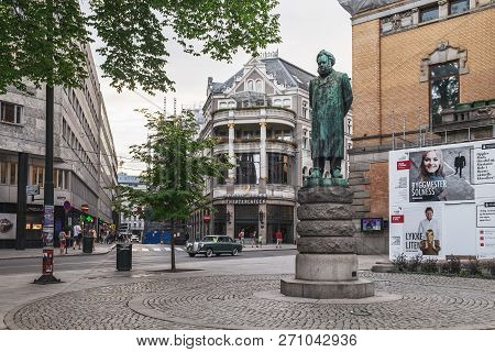 Oslo, Norway - August 3, 2018: Statue Of Henrik Ibsen In Front Of The National Theater In Oslo, Norw