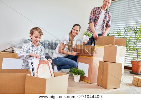 Family unpacks moving boxes when moving to a new home or house