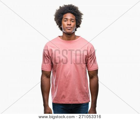 Afro american man over isolated background with serious expression on face. Simple and natural looking at the camera.