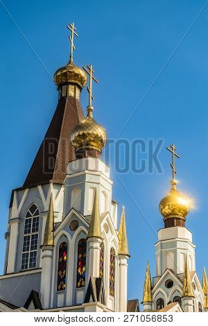 Russian Orthodox Church towers with three domes and crosses poster