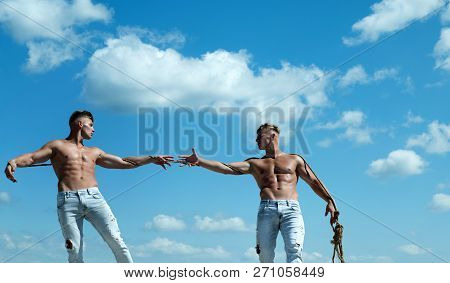 Primed for victory. Men shows off their strength against competitors. Athletic twins on opposite sides. Twins competitors with muscular bodies. Strong men pull rope with muscular hand strength. poster