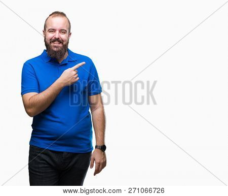 Young caucasian hipster man wearing blue shirt over isolated background cheerful with a smile of face pointing with hand and finger up to the side with happy and natural expression on face