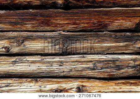 A Close Up Of The Wood Of The Log Cabin