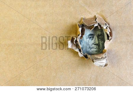 One Hundred Dollar Bill Concept. Franklin Portrait On A Hundred Dollars Bank Note Through The Hole.