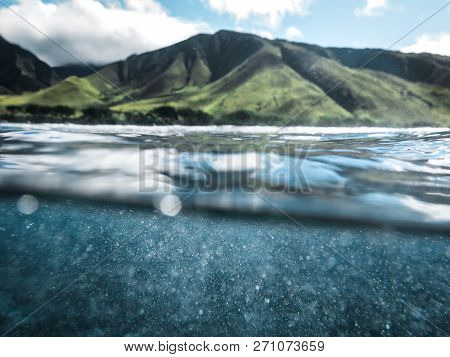 Cool Split Photo Half Underwater With Clear Blue Ocean Water Drops And Lush Green Mountain Backgroun