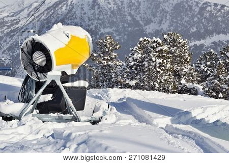 Snow Cannon On The Snow In The Mountains. Ski Resort In The Pyrenees, Andorra, On A Sunny Winter Day