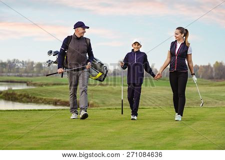 Happy Family Is Playing Golf In Autumn