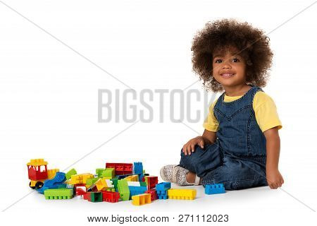 Lovely Little Cute African American Girl Playing On The Floor With Lots Of Colorful Plastic Blocks I