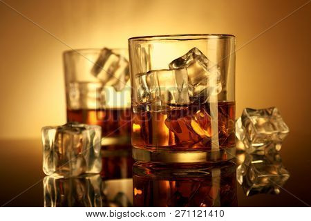 Two Chilled Whiskey Glass With Ice Cubes