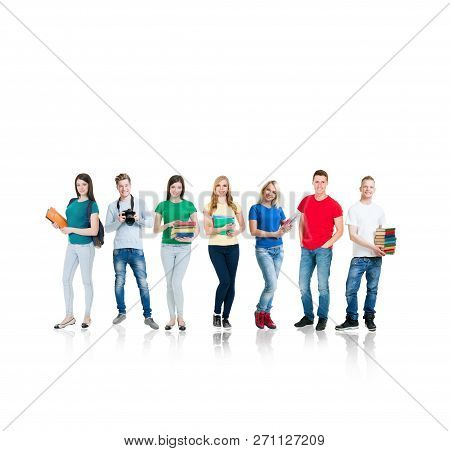 Large Group Of Smiling Friends Staying Together And Looking At Camera Isolated On White Background.