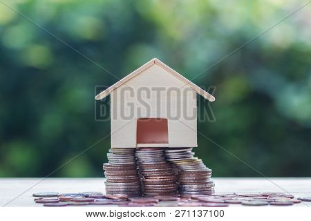 Home Loan, Mortgages, Debt, Savings Money For Home Buying Concept :stacked Coins And Small Residenti