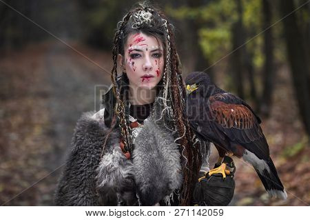 Portrait Of Beautiful Scandinavian Viking Woman Warrior With Traces Of Blood On Face And Battle Make