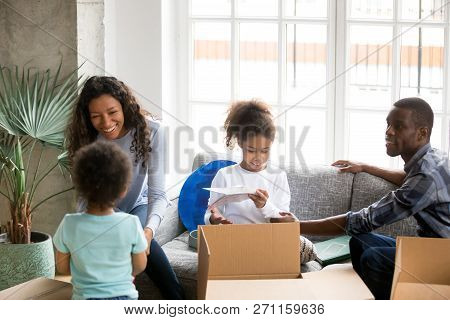 Happy African American Family Unpacking Boxes, Just Moving