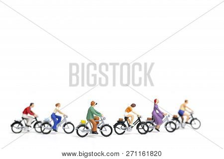 Miniature People : Friend Group Ride Bicycle  Isolate On White Background , Travel Concept