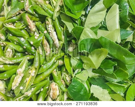 Green Peppers And Lime Leaves Background. Thai Food  Ingredient