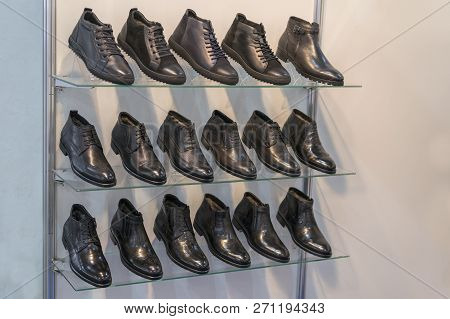 Mens Leather Shoes On The Shelf In The Store. Racks In The Store Of Clothes And Accessories. Shelves