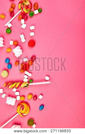 Colorful Candies On Pink  Background. Flat Lay