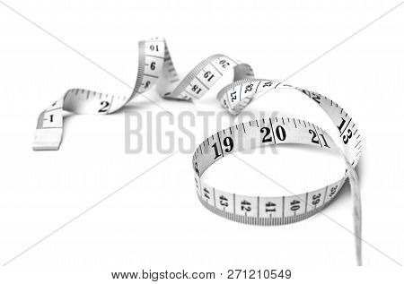 Curly Measure Tape, Dieting Or Weight Loss Theme, Isolated On White Background. Black And White Meas